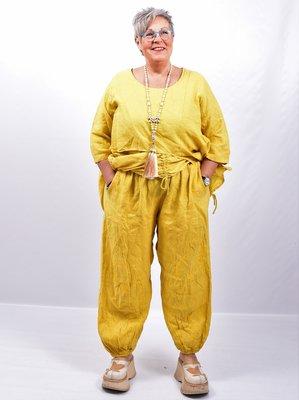 Broek, geel wijd model, steekzakken, rekbare taille, 100 % linnen, elastische zoom,