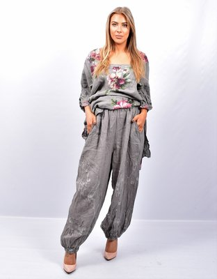 Broek, licht grijs wijd model, steekzakken, rekbare taille, 100 % linnen, elastische zoom,