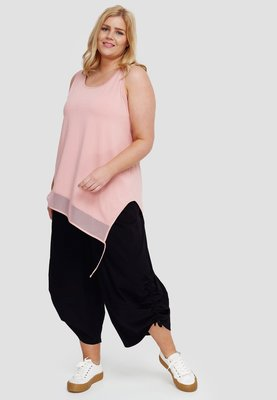 Top roze  mouwloos, asymmetrisch , tule rand  aan onderzijde, Kekoo