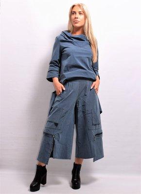 Kekoo  aparte wijde broek, jeansblauw met  rits, rekbare taille, zakken, 7/8ste lengte, asymmetrisch, stretchstof,